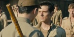 Louis Zamperini about to be whacked by sadistic guard.